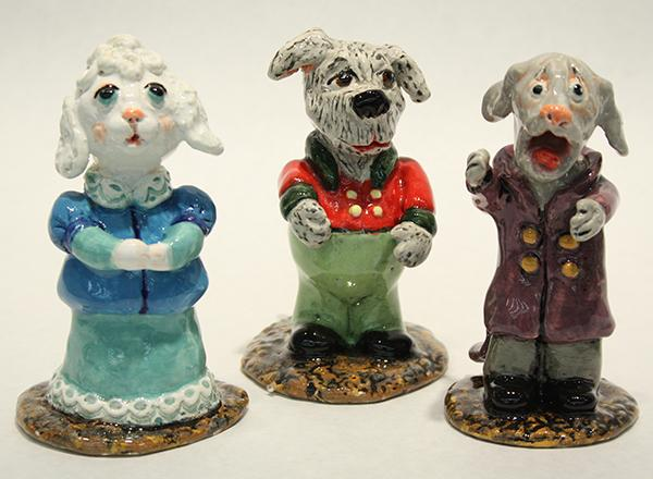 A group of handmade, ceramic singing dogs.