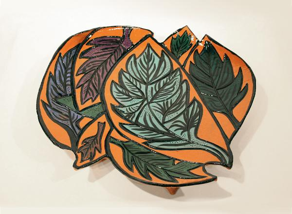Handmade platter with brightly colored plant images.
