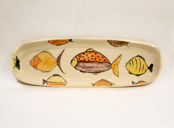 Handmade porcelain serving platter with fish images.