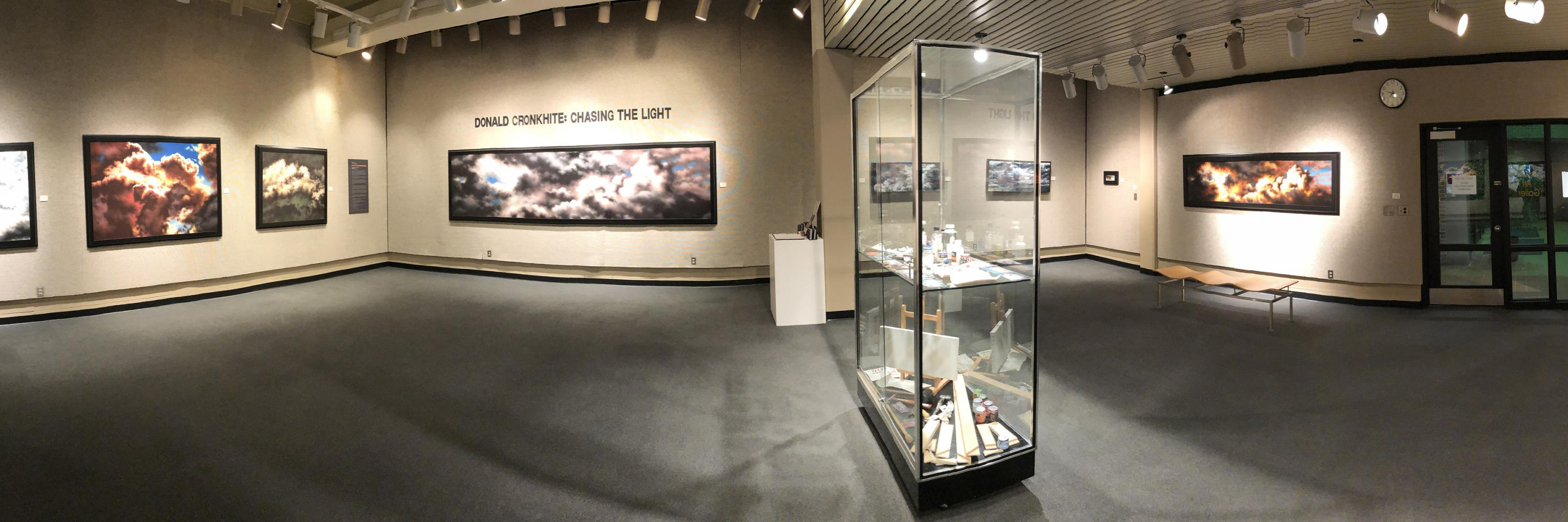 "Panoramic image of gallery exhibition ""Donald Cronkhite: Chasing The Light"""
